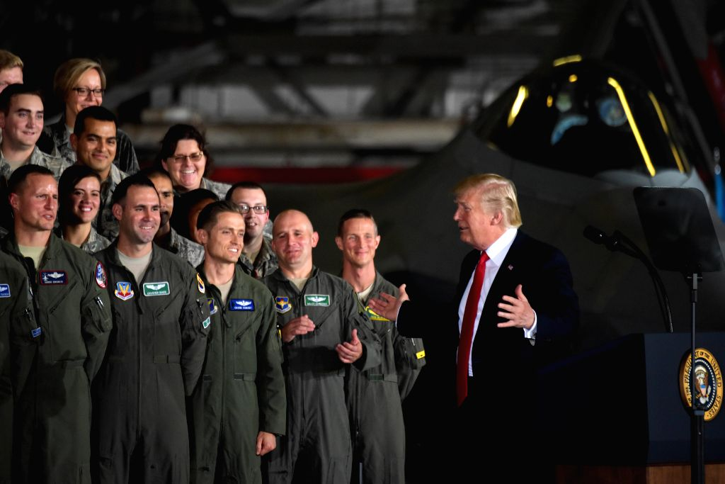 WASHINGTON, Sept. 15, 2017 - U.S. President Donald Trump (1st R) delivers remarks to military personnel and families at Joint Base Andrews in Maryland, the United States, on Sept. 15, 2017. U.S. ...