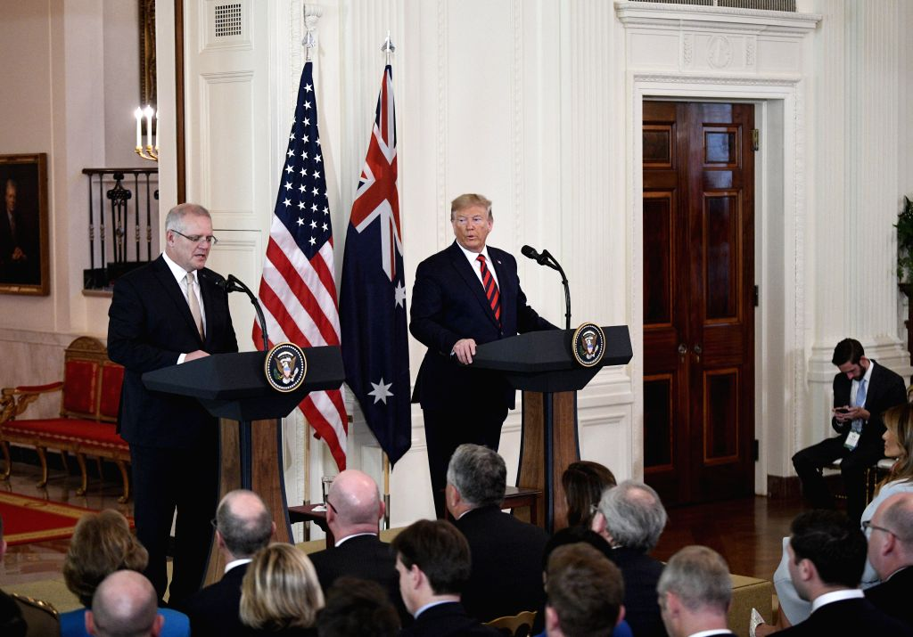 WASHINGTON, Sept. 20, 2019 - U.S. President Donald Trump (R, rear) attends a joint press conference with visiting Australian Prime Minister Scott Morrison at the White House in Washington D.C., the ... - Scott Morrison