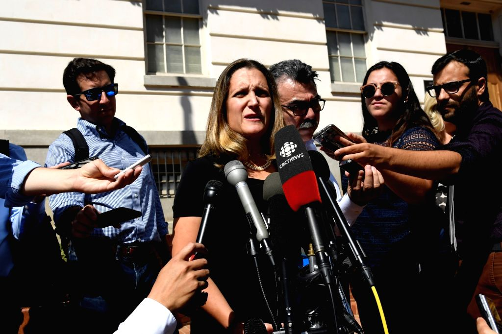 WASHINGTON, Sept. 5, 2018 (Xinhua) -- Canadian Foreign Minister Chrystia Freeland (C, Front) speaks to reporters before a new round of trade talks at Office of the U.S. Trade Representative in Washington D.C., the United States, on Sept. 5, 2018. Neg - Chrystia Freeland