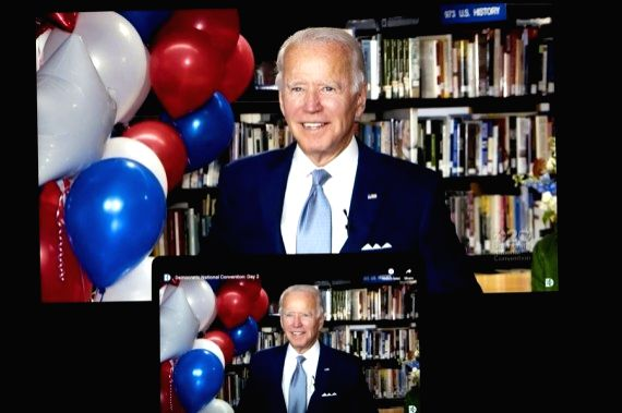 Washington, U.S. Democratic presidential nominee and former Vice President Joe Biden reacting in a video feed from Delaware is displayed on screens in Arlington, Virginia, the United States, on Aug. ...