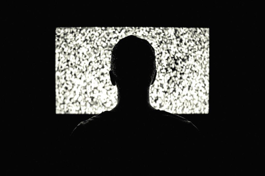 Watching TV in a dark.