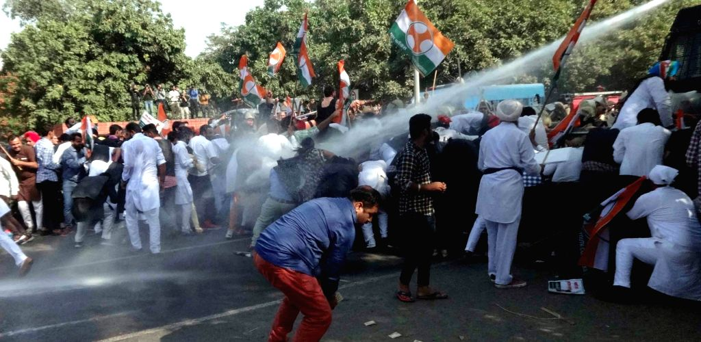 Water cannons being charged on Youth Congress workers demonstrating against Punjab government in Chandigarh on Oct 26, 2016.
