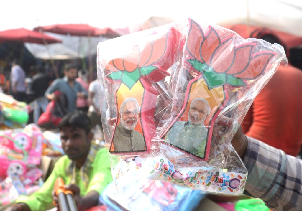 Water guns with picture of Prime Minister Narendra Modi being sold ahead of Holi , in New Delhi, on March 14, 2019. - Narendra Modi