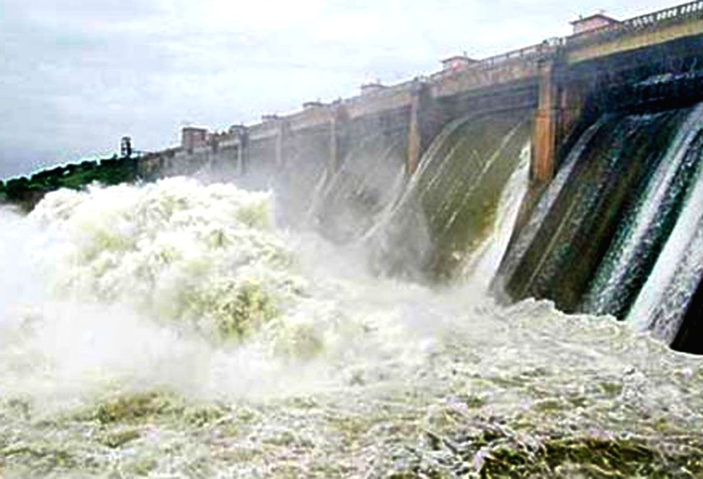 Water of Godavari river rushes out of the flood gates of the Kadam Dam in Adilabad district of Telangana on Sept 8, 2014.