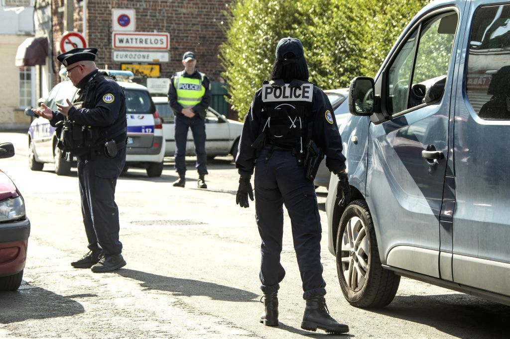 WATTRELOS (FRANCE), March 18, 2020 French police officers check vehicles in Wattrelos, French border city with Belgium, on March 18, 2020. As of Wednesday, France had registered 9,134 ...