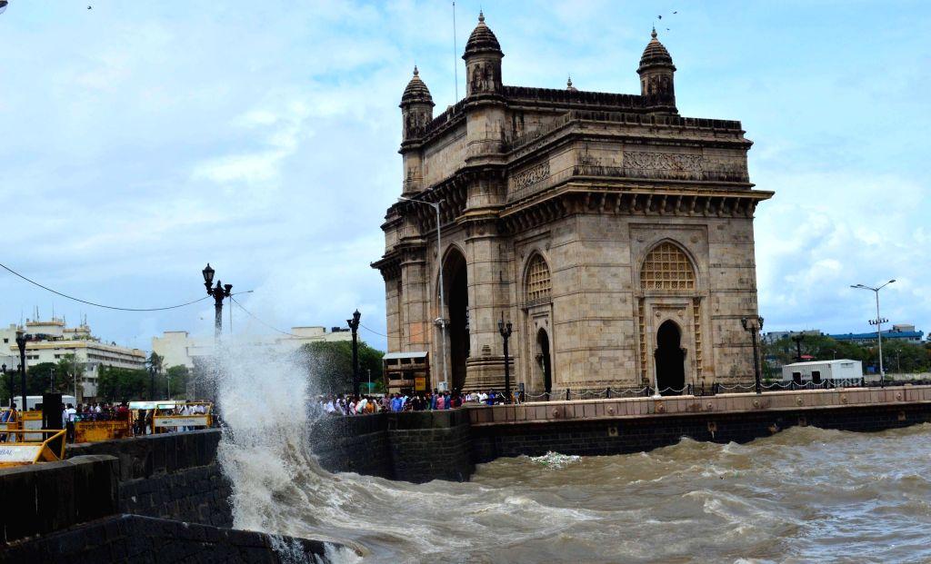 Waves hit walls near Gateway of India in Mumbai, on June 23, 2016.
