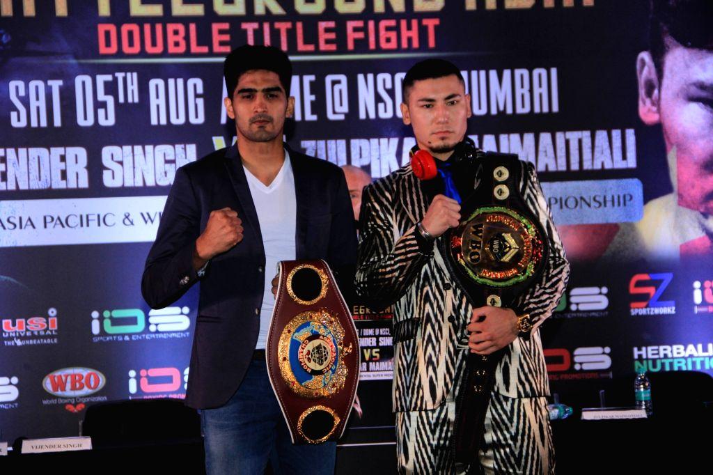 WBO Asia Pacific Super Middleweight champion Vijender Singh and WBO Oriental Super Middleweight champion Zulpikar Maimaitiali during a press conference regarding 'Battleground Asia' in ... - Vijender Singh