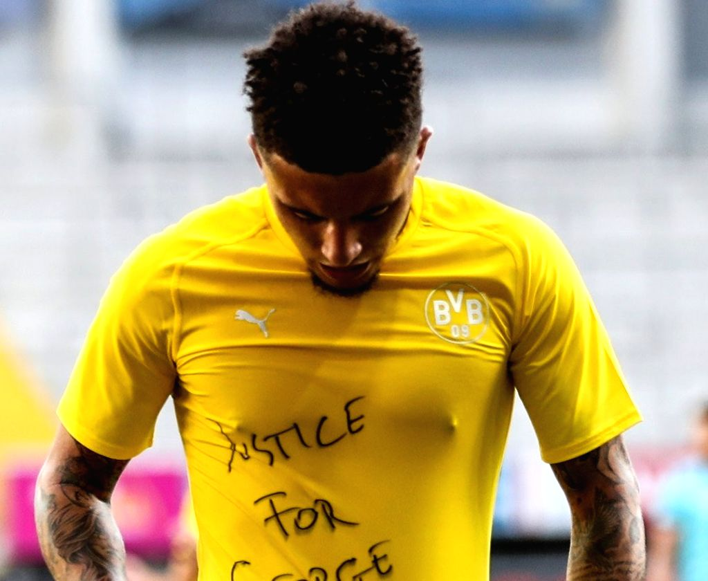 We are stronger together: Jadon Sancho pays tribute to George Floyd.