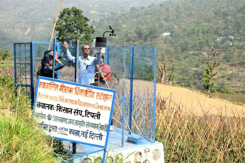 Weather station:  Residents of Tipli along with the experts monitor the micro weather grid.