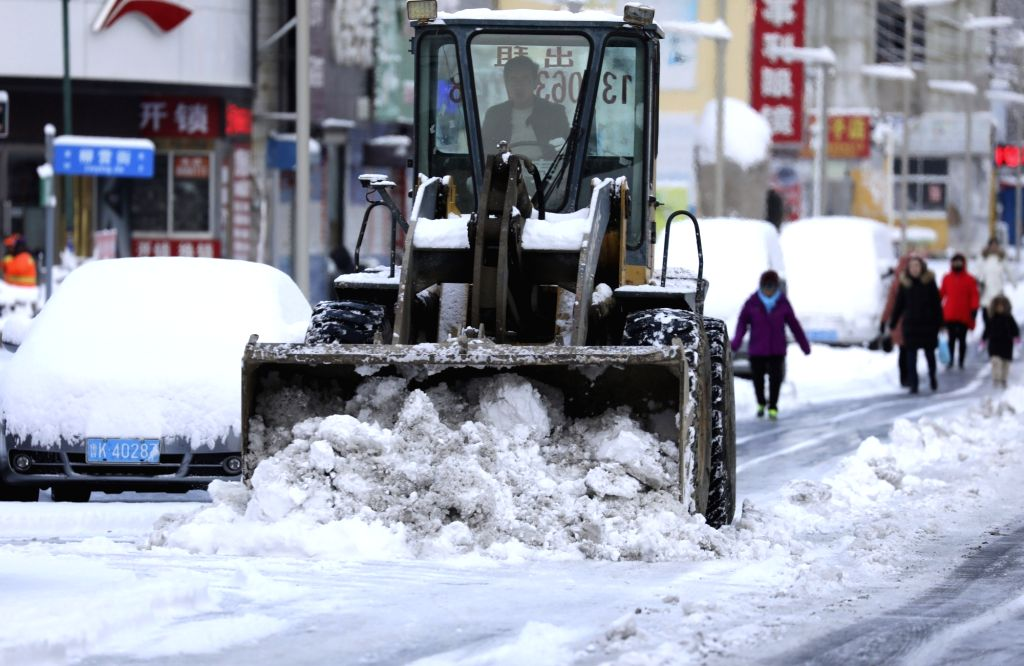 WEIHAI, Dec. 7, 2018 - A machine clears snow at Wendeng District in Weihai City, east China's Shandong Province, Dec. 7, 2018. Snowfall and sleet hit Shandong Friday.
