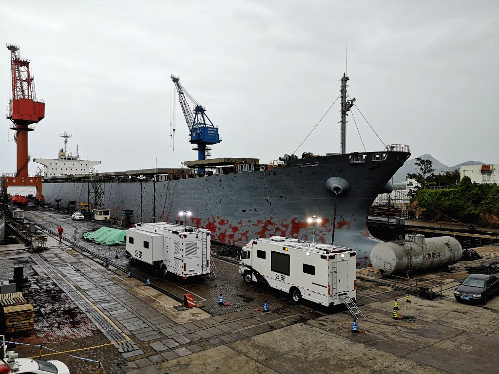 WEIHAI, May 26, 2019 - Photo taken with a mobile phone shows the cargo ship involved in a gas leak accident at Longyan Port in Weihai, east China's Shandong Province, May 26, 2019. Ten people died ...