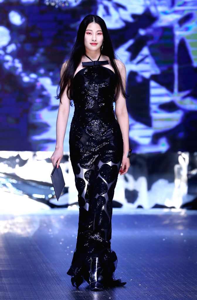 WEIHAI, May 27, 2017 - A model shows creations of Feraud during a fashion show in Weihai, east China's Shandong Province, May 27, 2017.