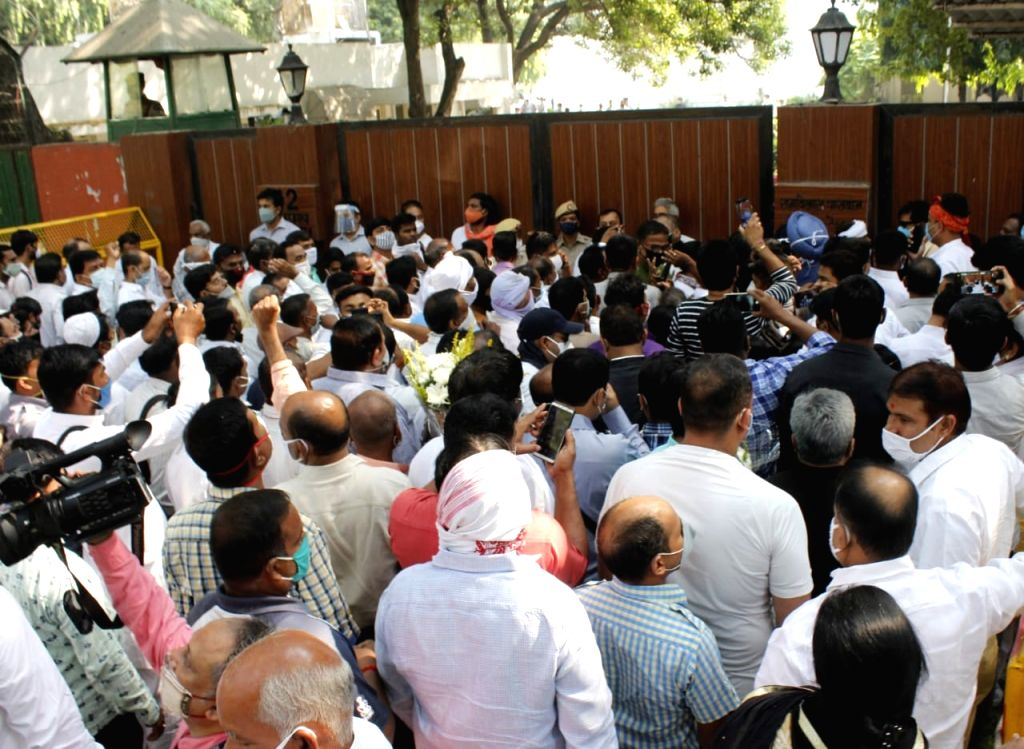 Well-wishers and party volunteers  stand  out side of Ram Vilas paswan resident to pay tribute who passed away on Thursday in New Delhi (photo: Qamar Sibtain)