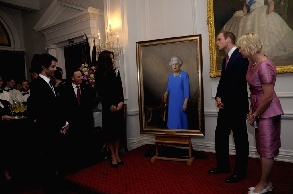 Picture released by New Zealand Government House shows that Britain's Prince William (2nd R) and his wife Catherine (3rd R) unveil a portrait of the Queen at ...