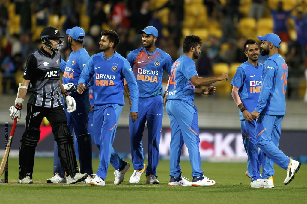 Wellington: Indian players celebrate fall of wicket Mitchell Santner during the 4th T20I match between India and New Zealand in Westpac Stadium in Wellington, New Zealand on Jan 31, 2020. (Photo: IANS)