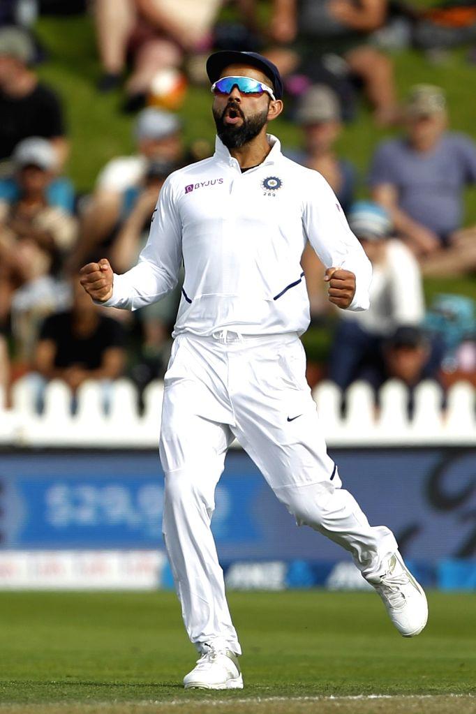 Wellington: Indian skipper Virat Kohli celebrates the wicket of Ross Taylor on Day 2 of the 1st Test match between India and New Zealand at the Basin Reserve cricket ground in Wellington, New Zealand on Feb 22, 2020. (Photo: Surjeet Yadav/IANS) - Virat Kohli and Surjeet Yadav
