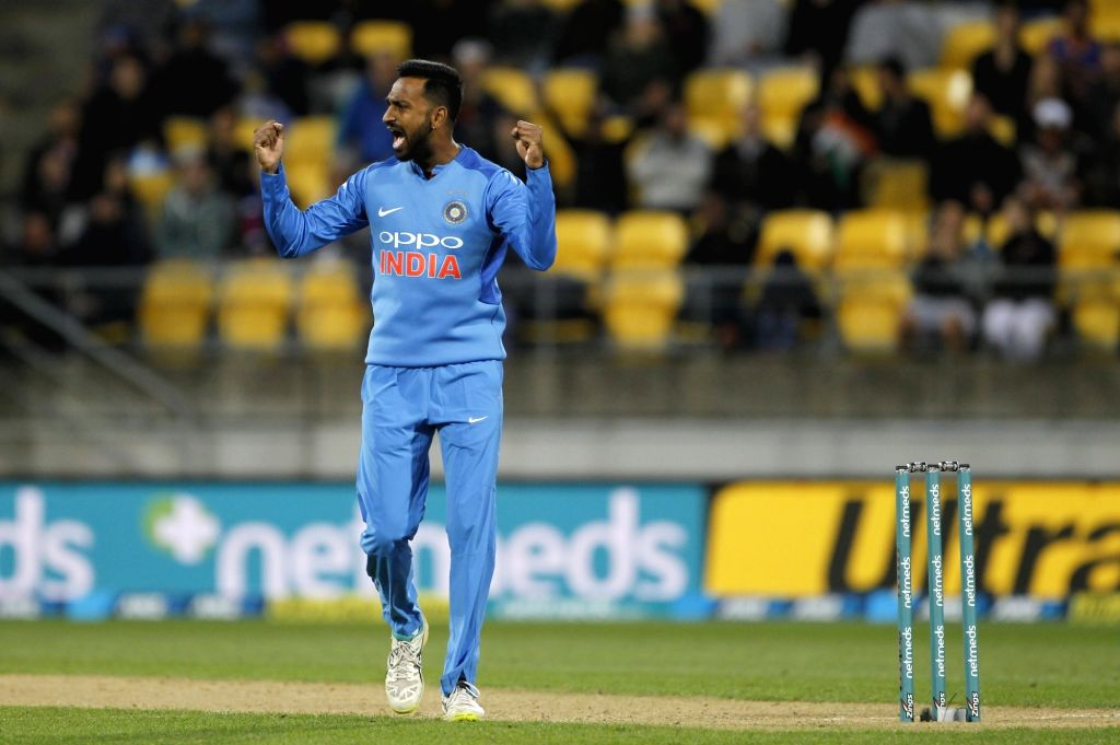 Wellington (New Zealand): India's Krunal Pandya celebrates the wicket of Colin Munro with teammates Murali Vijay and Yuzvendra Chahal during the first Twenty20 International match between India and ...