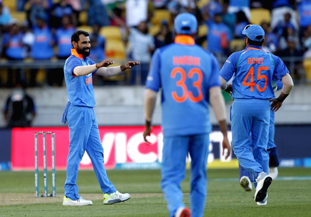 Wellington (New Zealand): India's Mohammed Shami celebrates the wicket of Colin Munro with teammates during the fifth ODI match between India and New Zealand at Westpac Stadium in Wellington, New ...