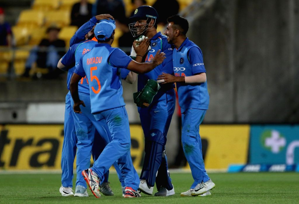Wellington (New Zealand): India's MS Dhoni celebrates the wicket of James Neesham during the fifth ODI match between India and New Zealand at Westpac Stadium in Wellington, New Zealand on Feb 3, 2019. (Photo: Surjeet Yadav/IANS) - MS Dhoni and Surjeet Yadav