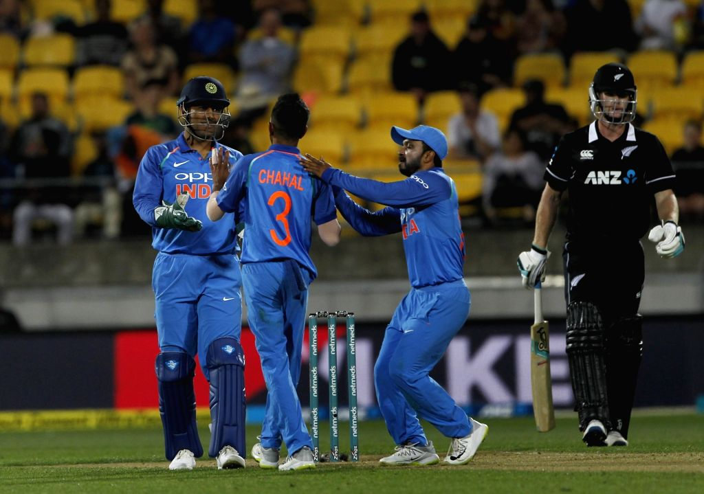 Wellington (New Zealand): India's Yuzvendra Chahal, MS Dhoni and Kedar Jadhav during the fifth ODI match between India and New Zealand at Westpac Stadium in Wellington, New Zealand on Feb 3, 2019. - MS Dhoni
