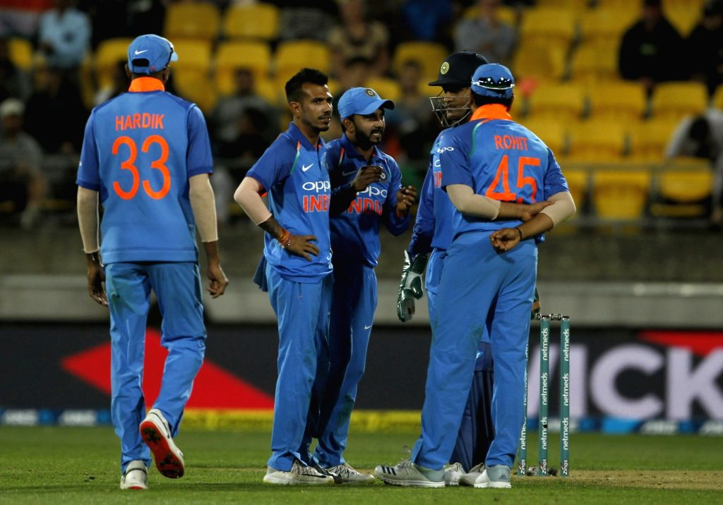 Wellington (New Zealand): Indian skipper Rohit Sharma with teammates Yuzvendra Chahal, Kedar Jadhav, Hardik Pandya and MS Dhoni during the fifth ODI match between India and New Zealand at Westpac ... - MS Dhoni and Rohit Sharma
