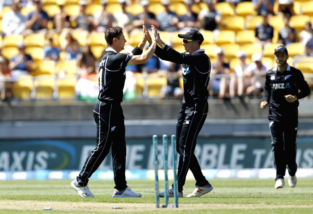 Wellington (New Zealand): New Zealand bowler Matt Henry celebrates with teammates the wicket of Indian batsman Rohit Sharma during the fifth ODI between India and New Zealand at Westpac Stadium, ... - Matt Henry and Rohit Sharma