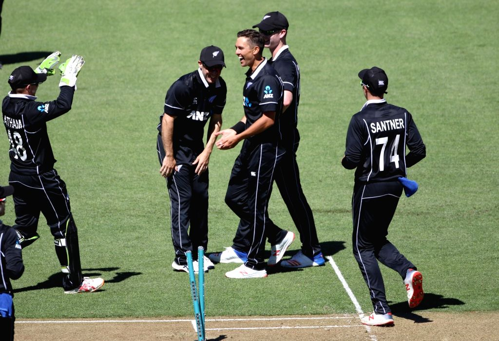 Wellington (New Zealand): New Zealand bowler Trent Boult celebrates the wicket of Indian batsman MS Dhoni during the fifth ODI between India and New Zealand at Westpac Stadium, Wellington on Feb. 3, ... - Trent Boult and MS Dhoni