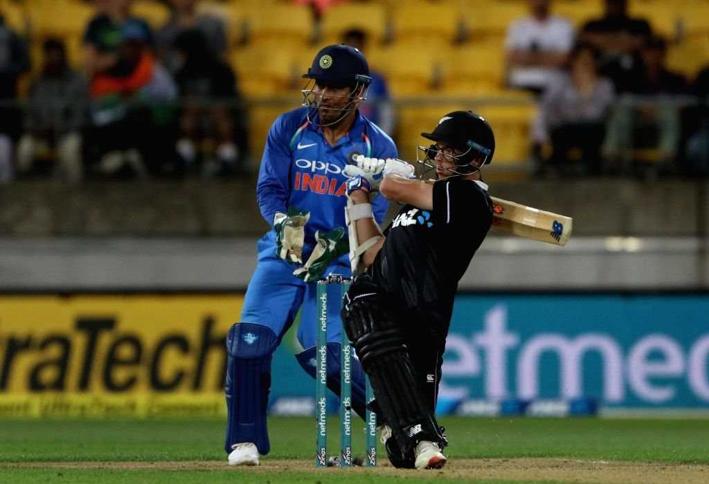 Wellington (New Zealand): New Zealand's Mitchell Santner in action during the fifth ODI match between India and New Zealand at Westpac Stadium in Wellington, New Zealand on Feb 3, 2019. (Photo: Surjeet Yadav/IANS) - Surjeet Yadav