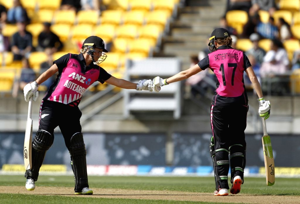 Wellington (New Zealand): New Zealand's Sophie Devine and Amy Satterthwaite during the first women's Twenty20 International match between India and New Zealand at Westpac Stadium in Wellington, New Zealand on Feb 6, 2019. (Photo: Surjeet Yadav/IANS) - Surjeet Yadav