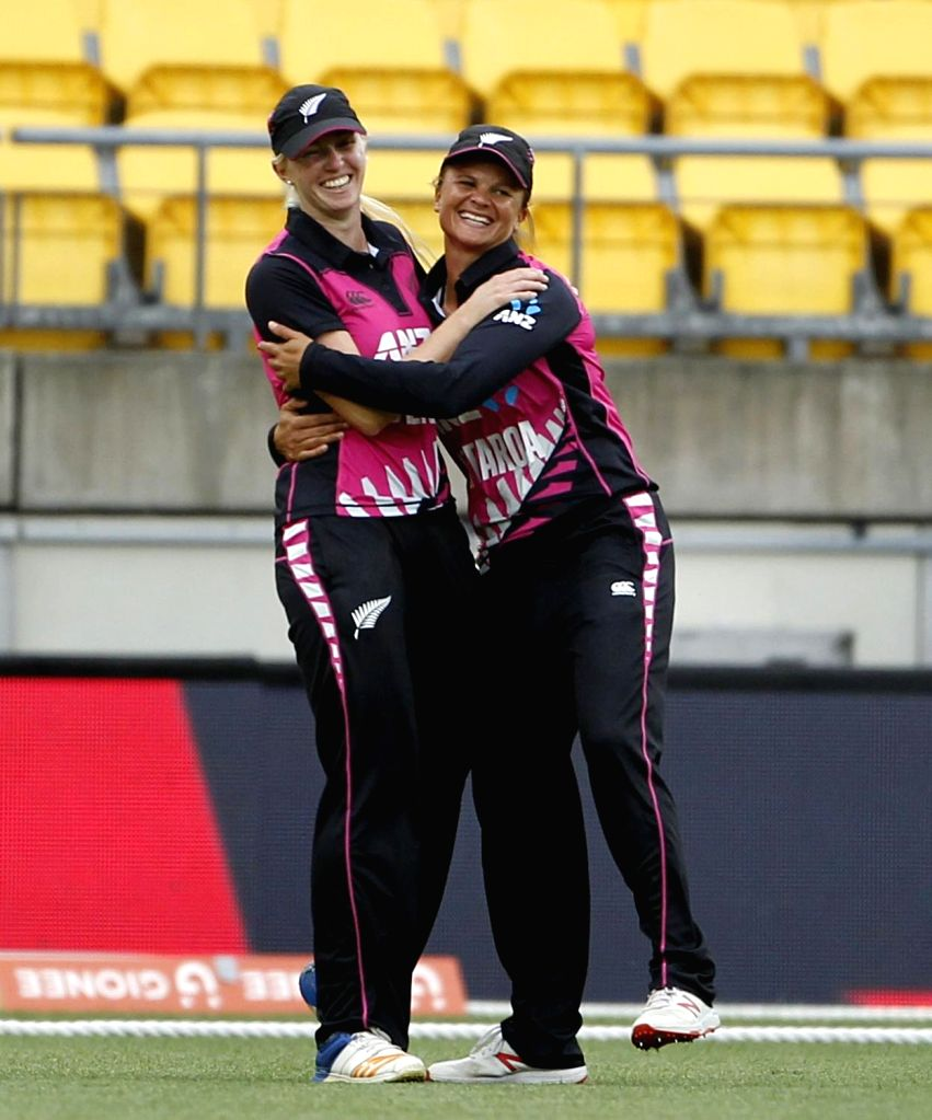 Wellington (New Zealand): New Zealand's Sophie Devine and Suzie Bates celebrate the wicket of Smriti Mandhana during the first women's Twenty20 International match between India and New Zealand at Westpac Stadium in Wellington, New Zealand on Feb 6,  - Surjeet Yadav