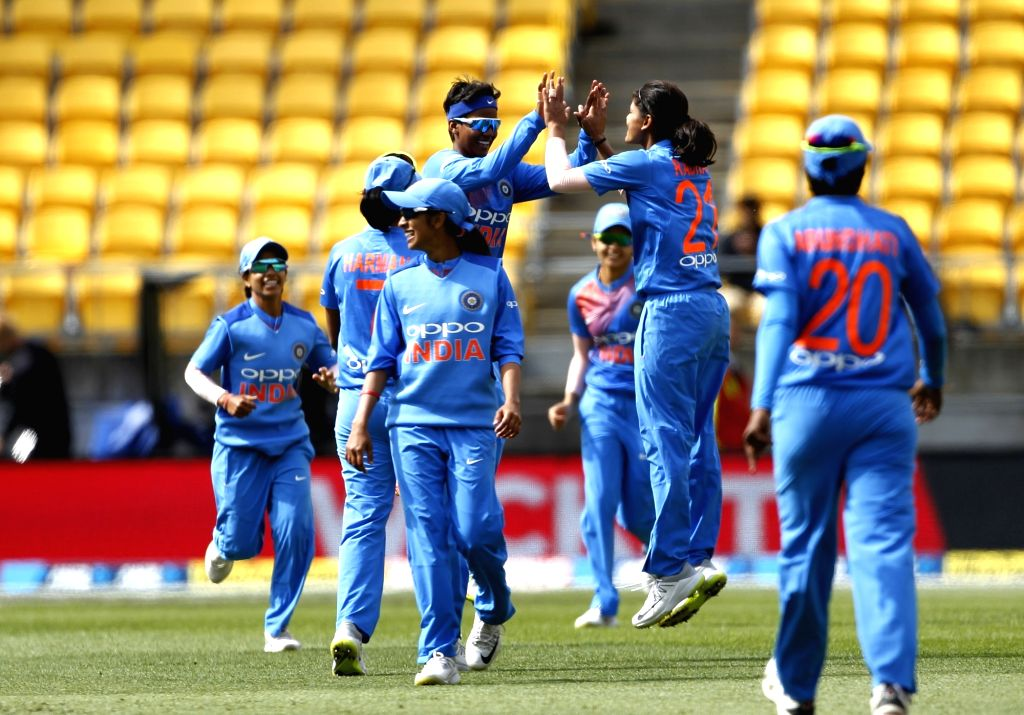 Wellington (New Zealand):  The women's team of India celebrates the wicket of Suzie Bates during the first women's Twenty20 International match between India and New Zealand at Westpac Stadium in ...