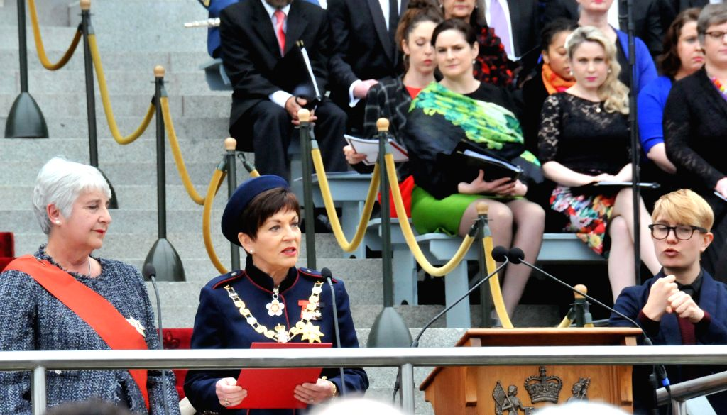WELLINGTON, Sept. 28, 2016 - New Zealand's 21st Governor-general Dame Patsy Reddy (2nd L) reads oath on the forecourt of the New Zealand Parliament in Wellington, New Zealand, Sept. 28, 2016. Dame ... - Patsy Reddy