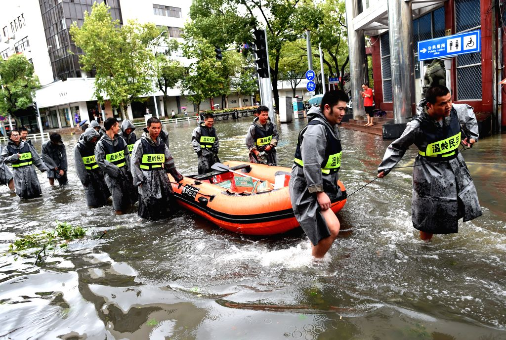 WENLING, Aug. 10, 2019 (Xinhua) -- Staff members transfer relief supplies via a rubber dinghy in Wenling, east China's Zhejiang Province, Aug. 10, 2019. At around 1:45 a.m., the center of Typhoon Lekima, the ninth typhoon of the year, made landfall i