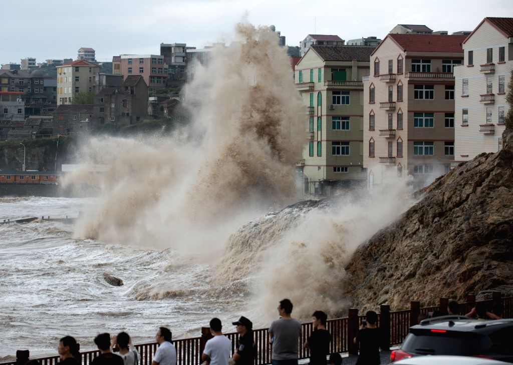 WENLING, Sept. 14, 2017 - Local residents watch surges brought by Typhoon Talim at Shitang Town in Wenling City, east China's Zhejiang Province, Sept. 14, 2017. China's national weather observatory ...