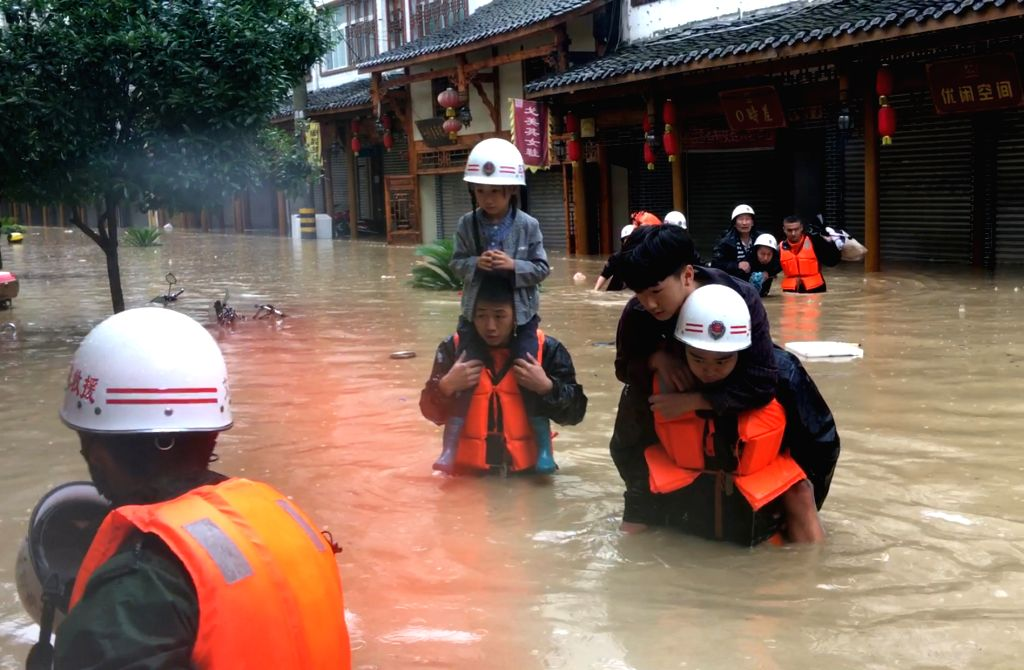 WENXIAN, July 11, 2018 - Rescuers evacuate residents as heavy rain hits Bikou Township in Wenxian County, northwest China's Gansu Province, July 11, 2018. Many low-lying areas were inundated and ...