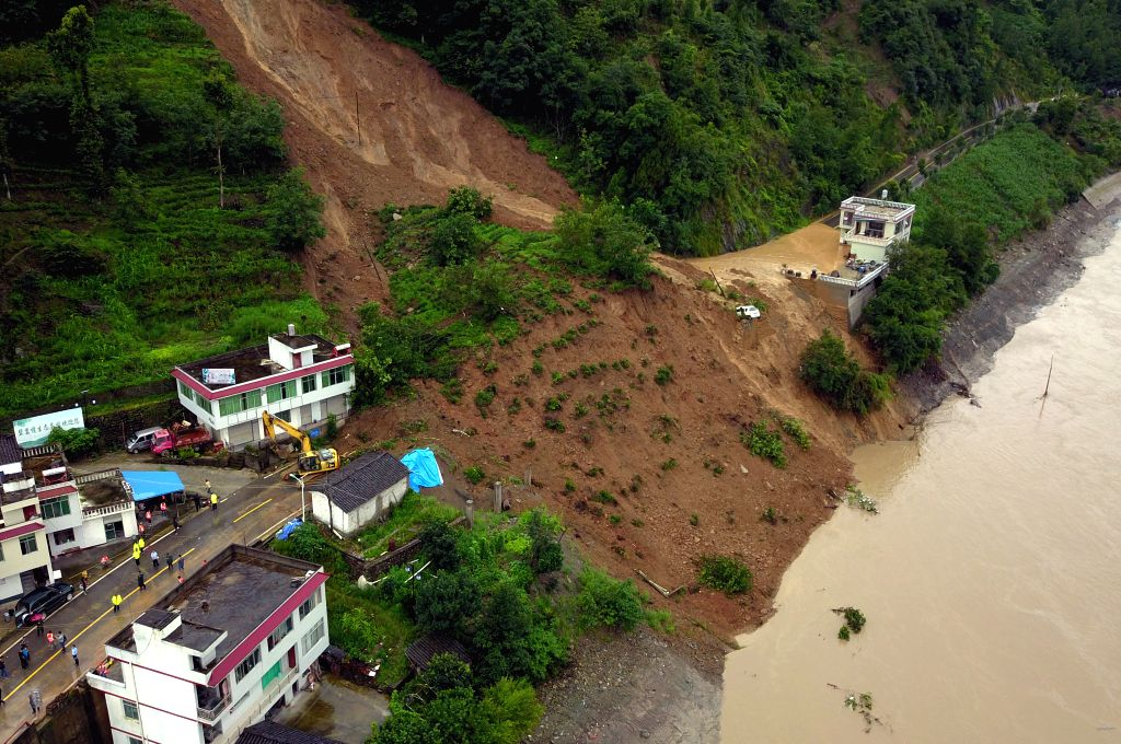 WENXIAN, July 12, 2018 - Rescuers clear up a national highway cut by a landslide in Bikou Town of Wenxian County, northwest China's Gansu Province, July 12, 2018. Water levels in the Yangtze River ...