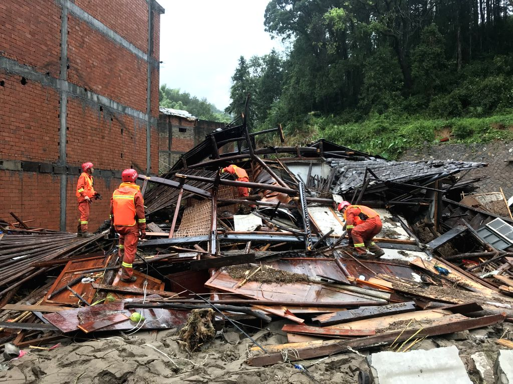 WENZHOU, Aug. 10, 2019 - Rescuers are seen at the typhoon damaged area in Shanzao Village of Yantan Town in Yongjia County, east China's Zhejiang Province, Aug. 10, 2019. The death toll has risen to ...