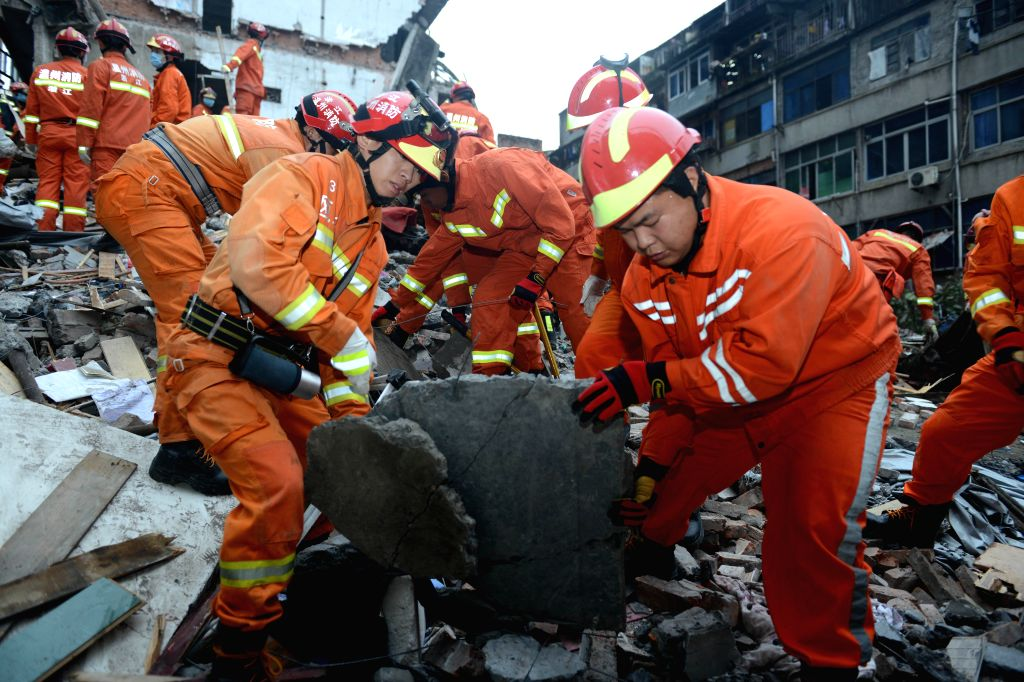 WENZHOU, Oct. 10, 2016 - Rescuers search for survivors at the accident site after four residential houses collapsed in Wenzhou City, east China's Zhejiang Province, Oct. 10, 2016. Four people were ...