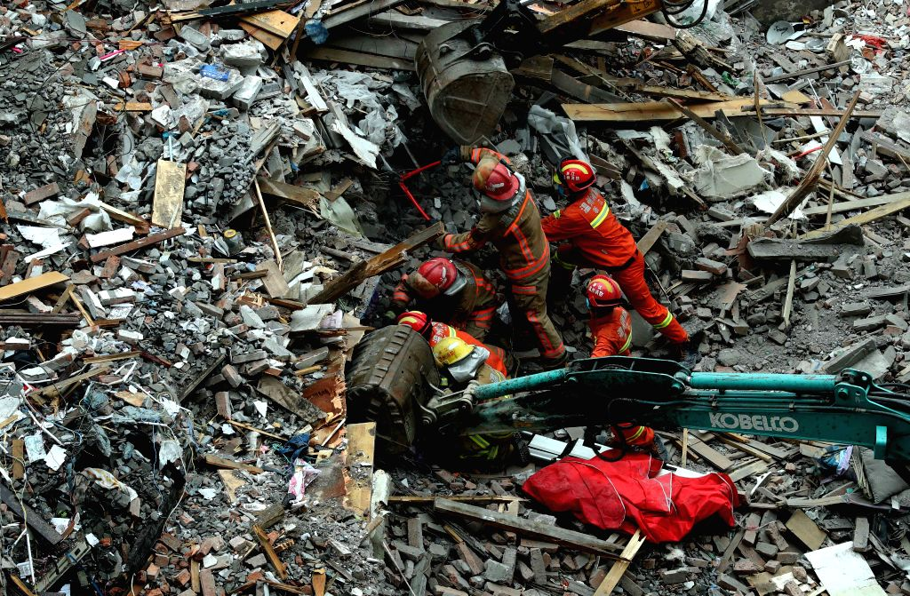 WENZHOU, Oct. 10, 2016 - Rescuers search for survivors at the accident site after four residential houses collapsed in Lucheng industrial district in Wenzhou City, east China's Zhejiang Province, ...