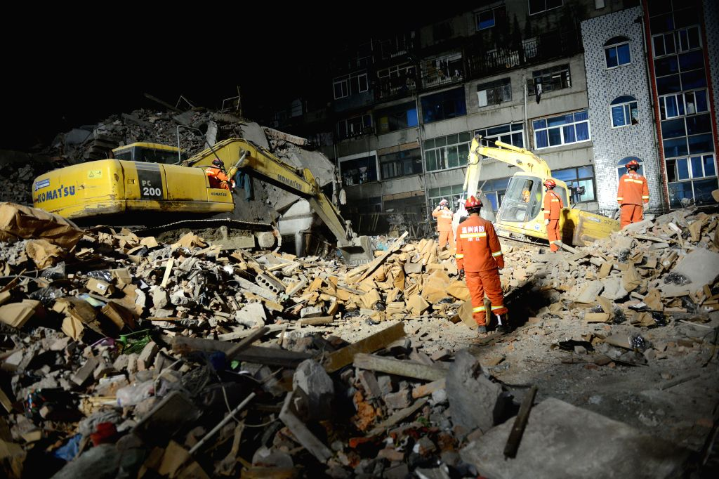 WENZHOU, Oct. 11, 2016 - Rescuers search for survivors at the accident site in Lucheng industrial district in Wenzhou City, east China's Zhejiang Province, Oct. 11, 2016. Twenty-two people have been ...