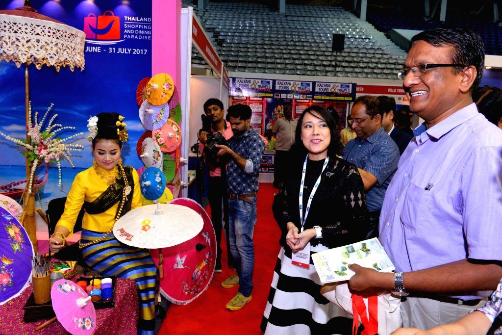 West Bengal Additional Chief Secretary to Governor Manish Jain and Royal Thai Consulate General Deputy Consul General Sirinapa Sinpattananukul during Travel and Tourism Fair, in Kolkata on ... - Manish Jain
