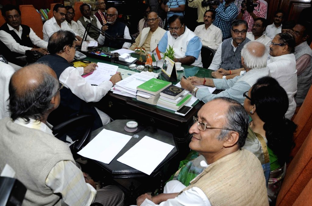 West Bengal Assembly Speaker Biman Banerjee holds an all party meeting ahead of the winter session in Kolkata, on Dec 7, 2015. Also seen West Bengal Ministers Amit Mitra and Partha ... - Biman Banerjee, Amit Mitra and Partha Chatterjee