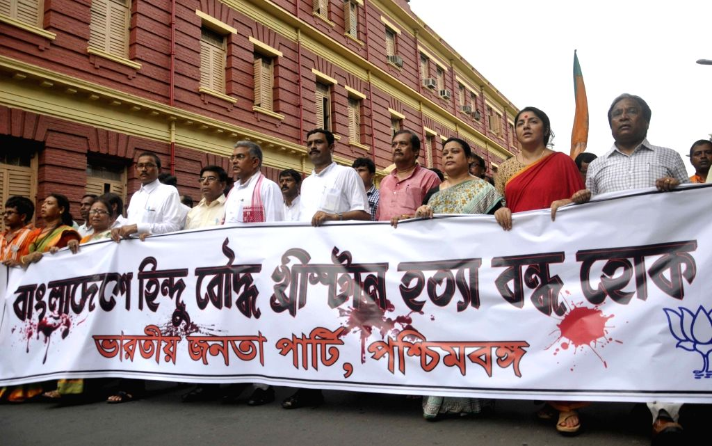 West Bengal BJP chief Dilip Ghosh with party leaders Rahul Sinha, Locket Chatterjee and others participates in a protest rally against attack on minorities in Bangladesh; in Kolkata on July ... - Dilip Ghosh, Rahul Sinha and Chatterjee