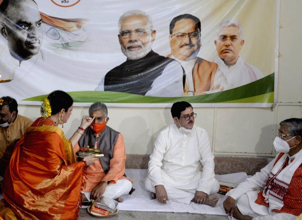 West Bengal BJP Mahila Morcha President Agnimitra Paul celebrates Bhai Dooj with State BJP President Dilip Ghosh at the state BJP headquarters, in Kolkata on Nov 16, 2020. - Dilip Ghosh