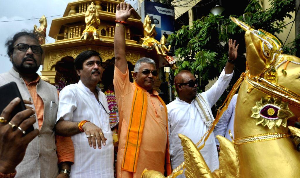 West Bengal BJP president Dilip Ghosh participates in Jagannath Rath Yatra, in Kolkata on July 14, 2018. - Dilip Ghosh