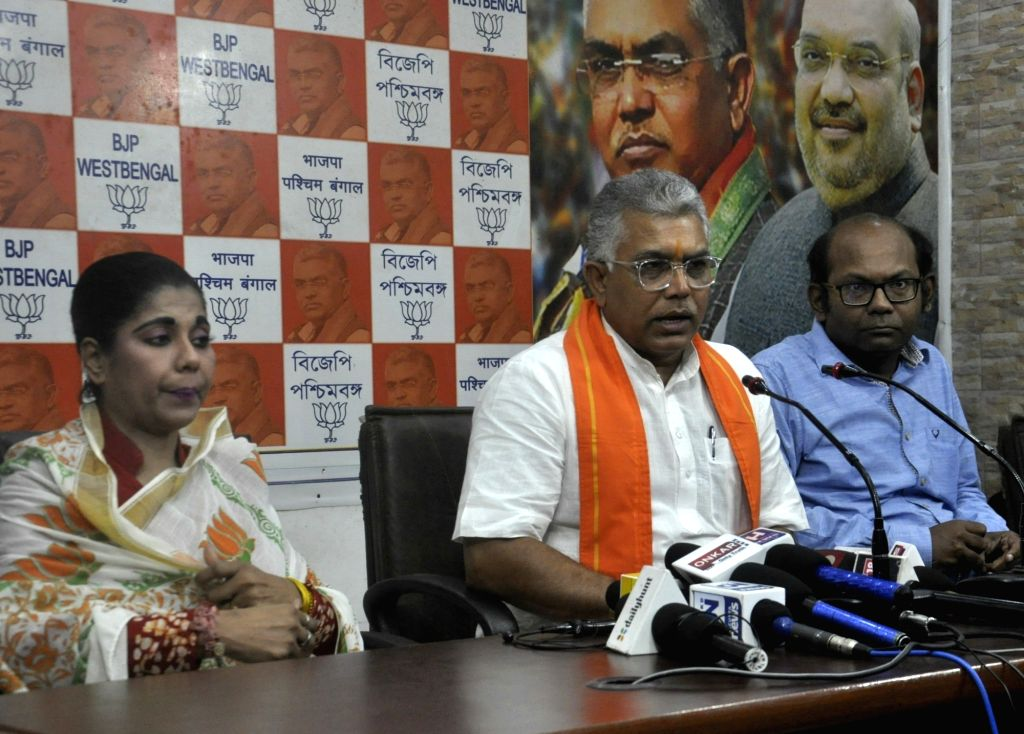 West Bengal BJP President Dilip Ghosh accompanied by party leader Bharati Ghosh, addresses a press conference, at the state party headquarters in Kolkata on Oct 14, 2019. - Dilip Ghosh and Bharati Ghosh