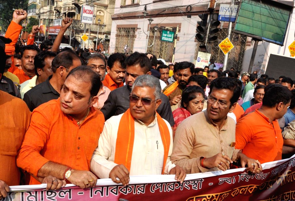 West Bengal BJP President Dilip Ghosh along with party leaders marching towards Kolkata Municipal Headquarter protesting against spurt in dengue cases, in Kolkata on Nov 13, 2019. - Dilip Ghosh