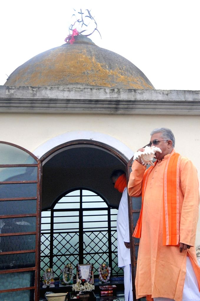 West Bengal BJP President Dilip Ghosh blows a conch as he offers prayers to Lord Ram and Lord Shiva on the occasion of Ram Temple 'Bhumi Pujan in Ayodhya; in Kolkata on Aug 5, 2020. - Dilip Ghosh