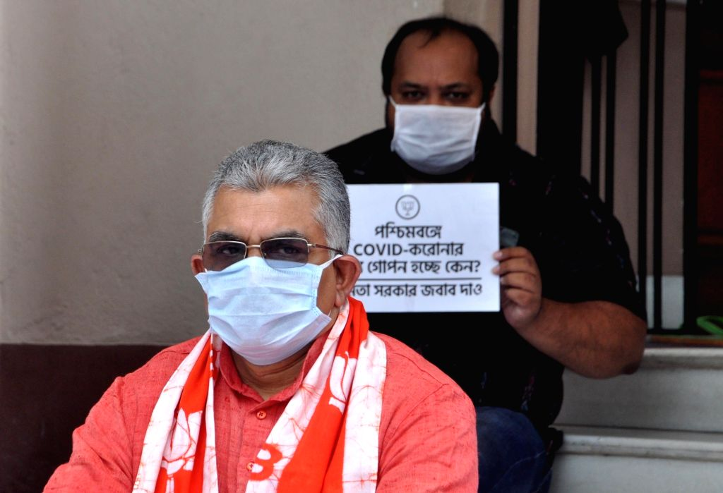West Bengal BJP President Dilip Ghosh stages a sit-in demonstration against the State Government over the current situation of COVID 19 pandemic and related issues, at his residence in ... - Dilip Ghosh