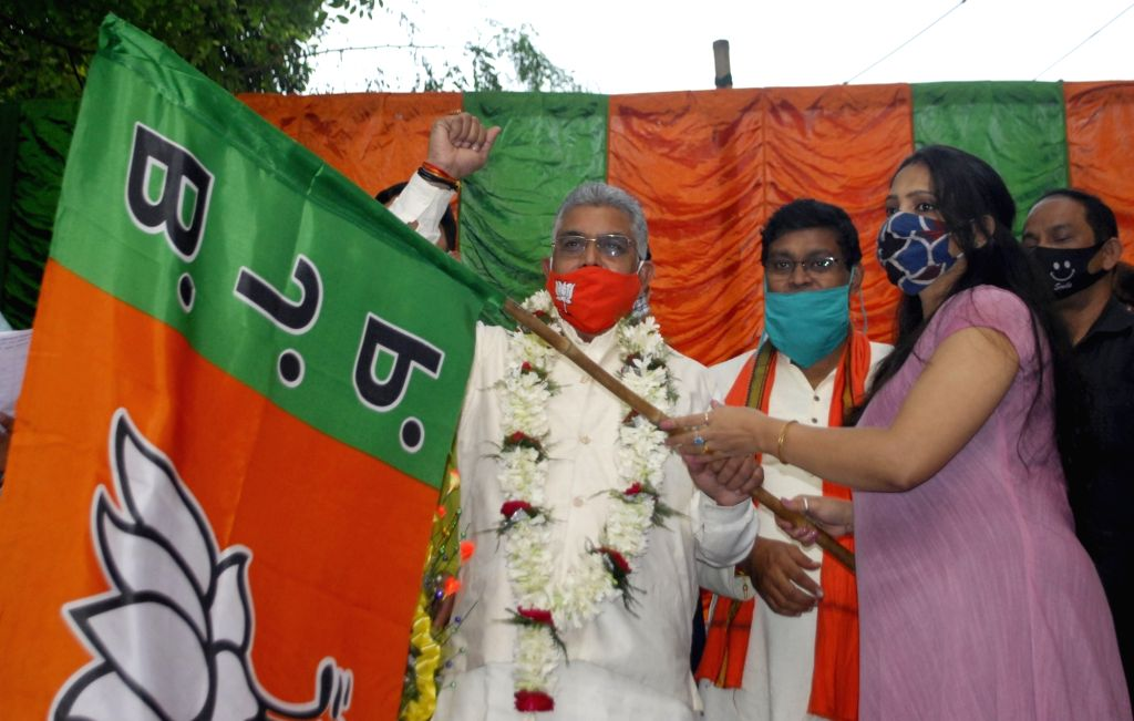 West Bengal BJP President Dilip Ghosh welcomes new members into the party, in Kolkata on Nov 21, 2020. - Dilip Ghosh